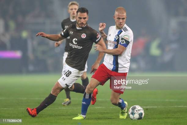 Rick van Drongelen of Haburger SV and Dimitrios Diamantakos of FC St. Pauli battle for possession during the Second Bundesliga match between FC St....