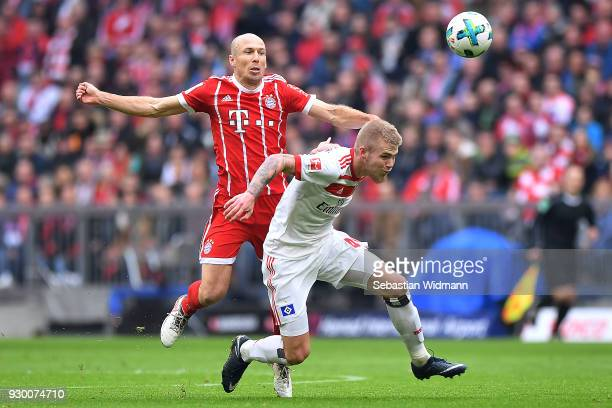 Rick van Drongelen of Hamburg and Arjen Robben of Bayern Muenchen fight for the ball during the Bundesliga match between FC Bayern Muenchen and...