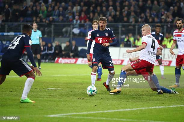 Rick van Drongelen of Hamburg and Thomas Mueller of Muenchen compete for the ball during the Bundesliga match between Hamburger SV and FC Bayern...
