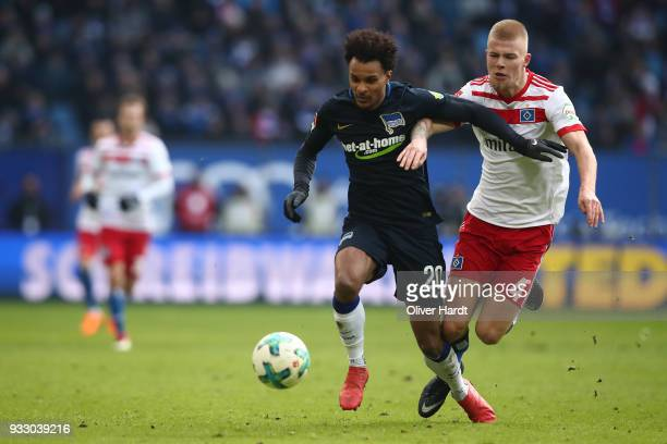 Rick van Drongelen of Hamburg and Valentino Lazaro of Berlin compete for the ball during the Bundesliga match between Hamburger SV and Hertha BSC at...