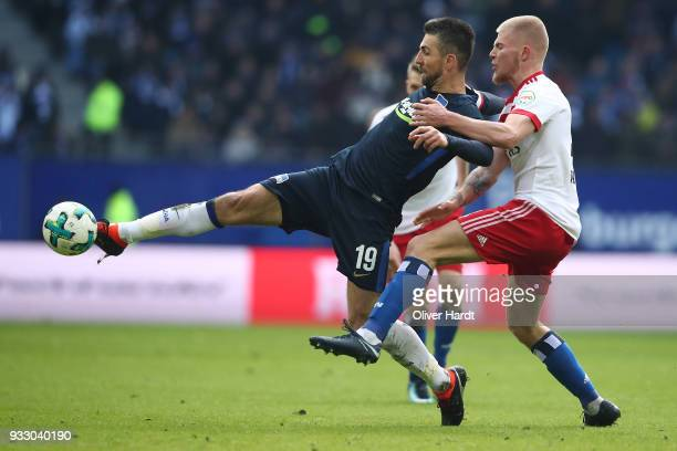Rick van Drongelen of Hamburg and Vedad Ibisevic of Berlin compete for the ball during the Bundesliga match between Hamburger SV and Hertha BSC at...