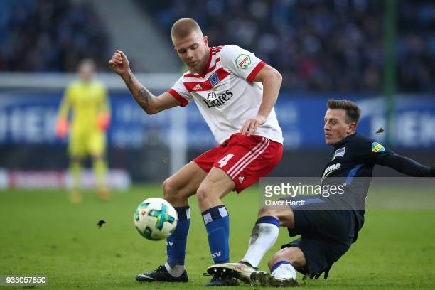 Rick van Drongelen of Hamburg and Vladimir Darida of Berlin compete for the ball during the Bundesliga match between Hamburger SV and Hertha BSC at...