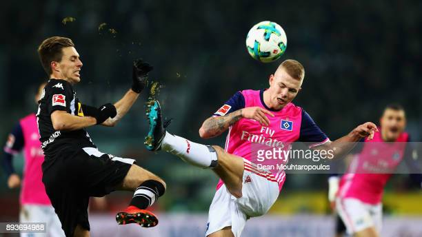 Rick van Drongelen of Hamburg battles for the ball with Patrick Herrmann of Borussia Monchengladbach during the Bundesliga match between Borussia...