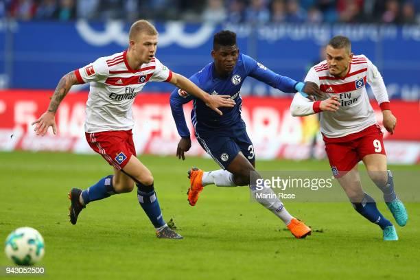 Rick van Drongelen of Hamburg Breel Embolo of Schalke and Kyriakos Papadopoulos of Hamburg fight for the ball during the Bundesliga match between...