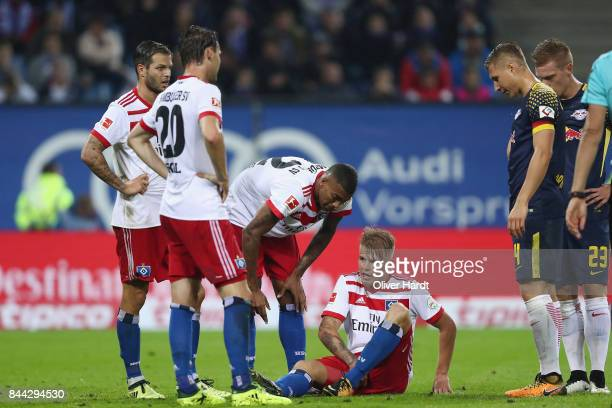 Rick van Drongelen of Hamburg sits on the pitch before being substituted during the Bundesliga match between Hamburger SV and RB Leipzig at...