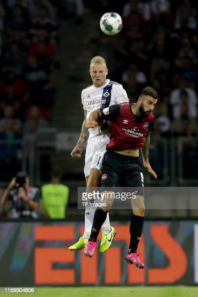 Rick Van Drongelen of Hamburger SV and Mikael Ishak of FC Nuernberg battle for the ball during the Second Bundesliga match between 1. FC Nuernberg...
