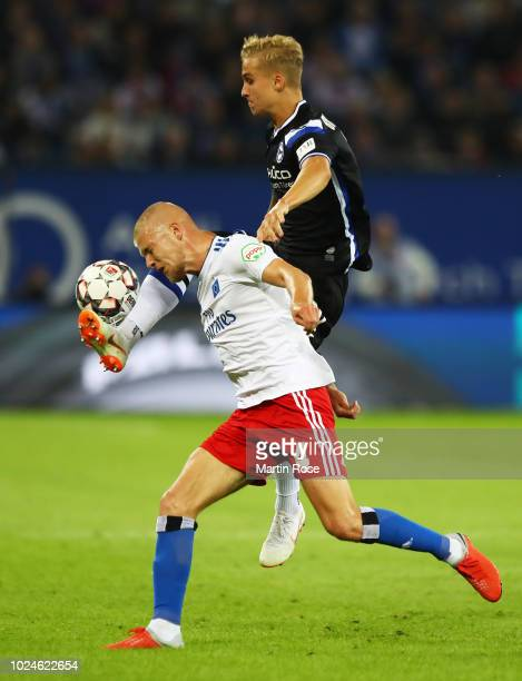 Rick van Drongelen of Hamburger SV is challenged by Nils Seufert of Arminia Bielefeld during the Second Bundesliga match between Hamburger SV and DSC...