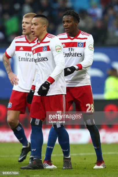Rick van DrongelenBobby Wood and Gideon Jung of Hamburg appears frustrated after the Bundesliga match between Hamburger SV and Hertha BSC at...