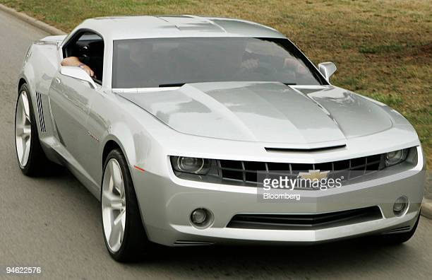 Rick Wagoner chairman and chief executive officer of General Motors Corp drives the Chevrolet Camaro concept vehicle down Woodward Ave as part of the...