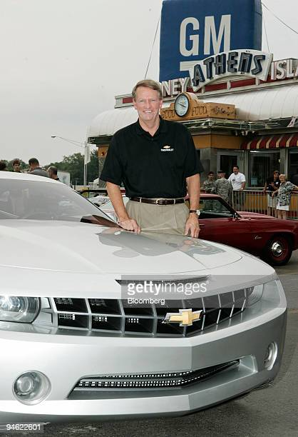 Rick Wagoner chairman and chief executive officer of General Motors Corp poses with the Chevrolet Camaro concept vehicle after driving it down...
