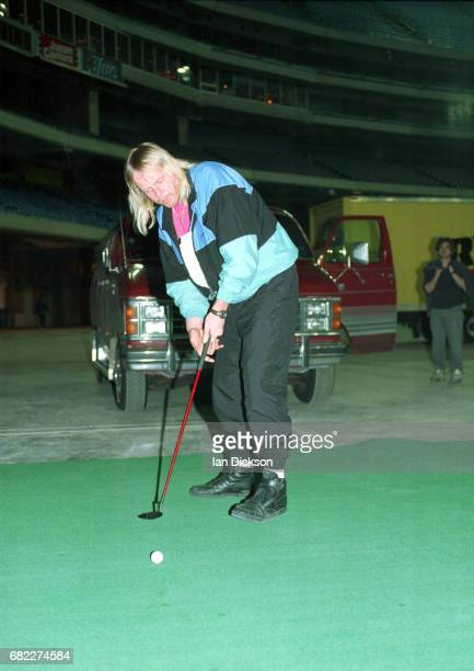 Rick Wakeman backstage practising golf putting on tour with reformed Yes Canada April 1991