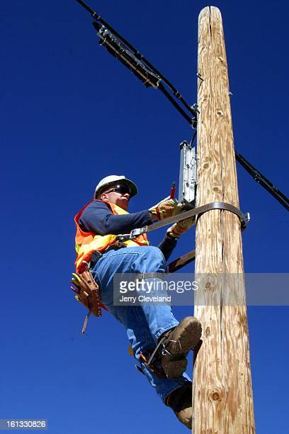 Rick White Qwest Communications network technician works on a box on a pole at the Qwest training center in Lakewood Wednesday 2/19