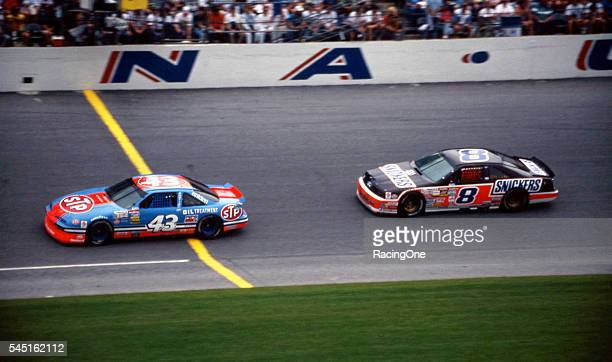 Rick Wilson driver of the Snickers Ford and seventime NASCAR champion Richard Petty driver of the Pontiac race in the Daytona 500 at Daytona...