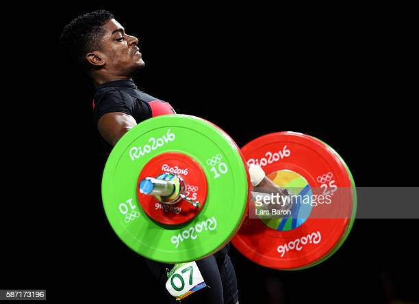 Rick Yves Confiance of Seychelles competes during the Men's 62kg Group B weightlifting contest on Day 3 of the Rio 2016 Olympic Games at the...