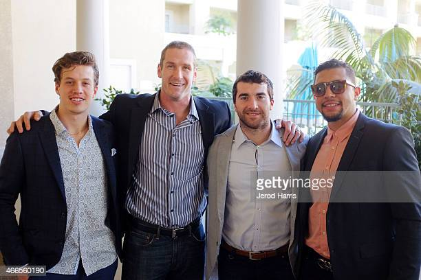 Rickard Rackell Tim Jackman Kyle Palmieri and Emerson Etem attend the Anaheim Lady Ducks Fashion Show Luncheon with Bloomingdale's South Coast Plaza...