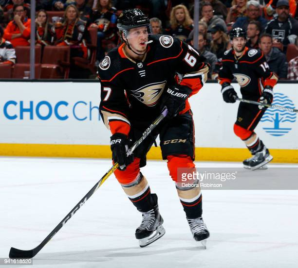 Rickard Rakell and Adam Henrique of the Anaheim Ducks skate during the game against the Los Angeles Kings on March 30 2018 at Honda Center in Anaheim...