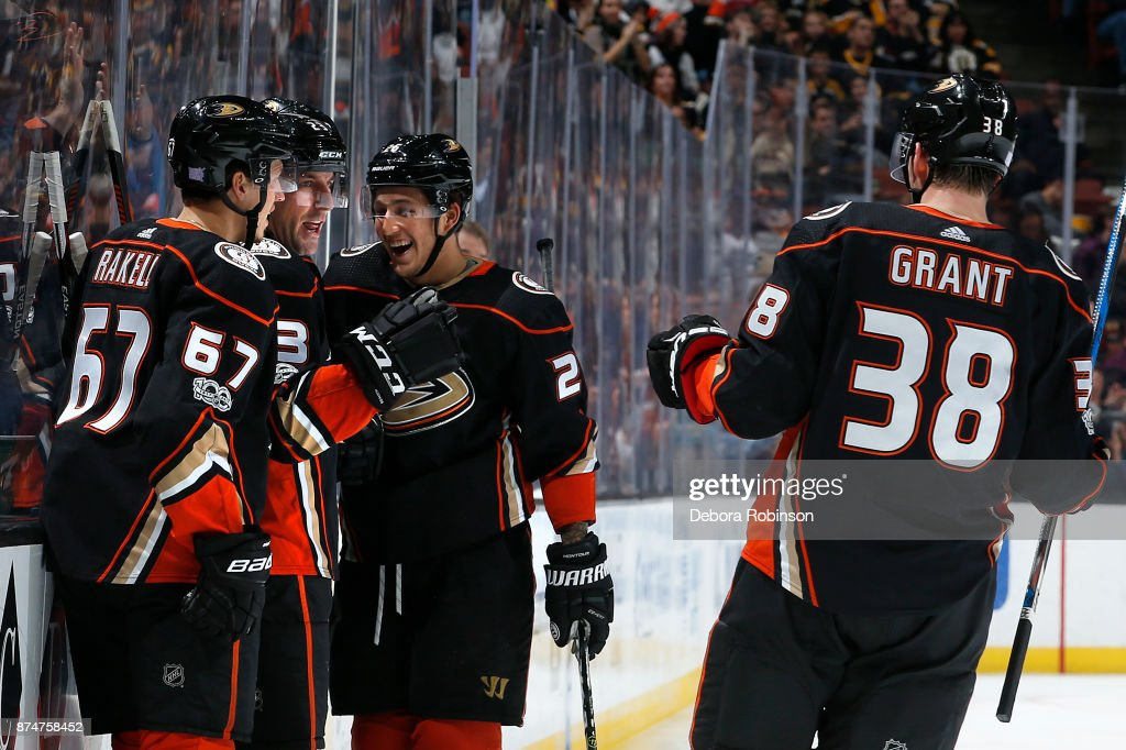 Rickard Rakell #67, Francois Beauchemin #23, Brandon Montour #26, and Derek Grant #38 of the Anaheim Ducks celebrate a goal in the third period of the game against the Boston Bruins on November 15, 2017 at Honda Center in Anaheim, California.