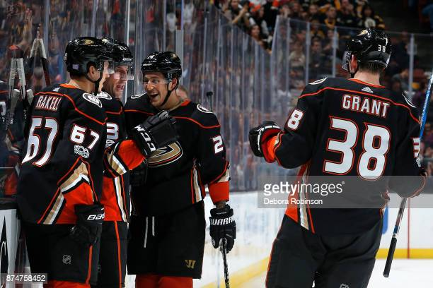 Rickard Rakell Francois Beauchemin Brandon Montour and Derek Grant of the Anaheim Ducks celebrate a goal in the third period of the game against the...
