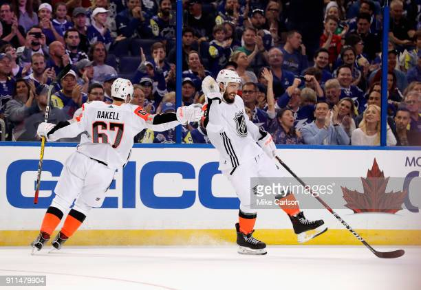 R} Rickard Rakell of the Anaheim Ducks and Drew Doughty of the Los Angeles Kings celebrate after a goal during the second half of the 2018 Honda NHL...
