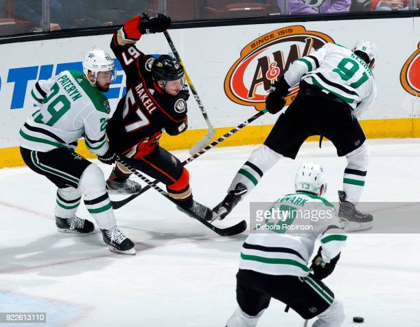 Rickard Rakell of the Anaheim Ducks battles for position against Greg Pateryn Tyler Seguin and Mattias Janmark of the Dallas Stars during the game on...