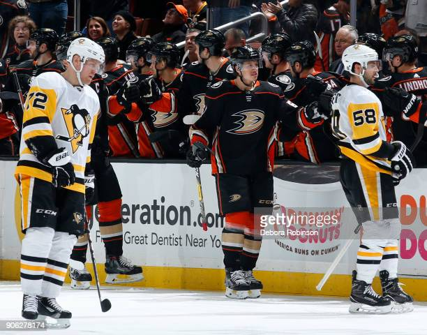 Rickard Rakell of the Anaheim Ducks celebrates his second period goal with his teammates against Patric Hornqvist and Kris Letang of the Pittsburgh...