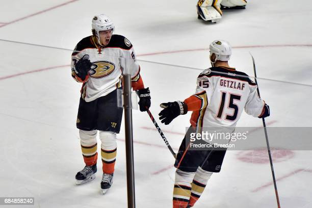 Rickard Rakell of the Anaheim Ducks celebrates with Ryan Getzlaf after scoring a goal against Pekka Rinne of the Nashville Predators during the first...