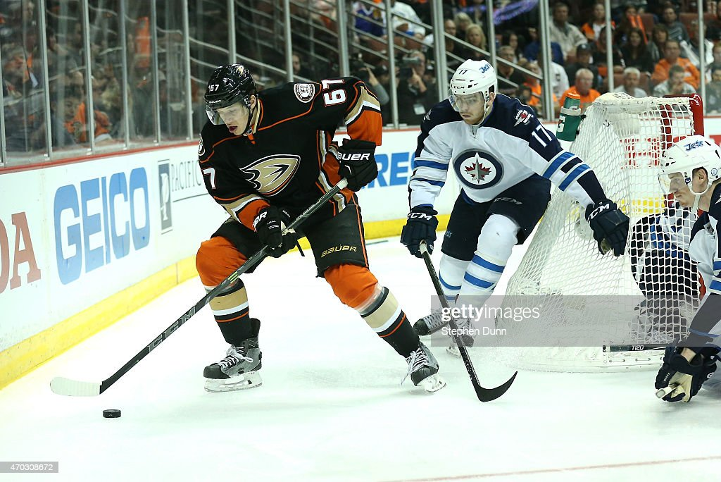 Rickard Rakell #67 of the Anaheim Ducks controls the puck against Adam Lowry #17 of the Winnipeg Jets in Game Two of the Western Conference Quarterfinals during the 2015 NHL Stanley Cup Playoffs at Honda Center on April 18, 2015 in Anaheim, California. The Ducks won 2-1.