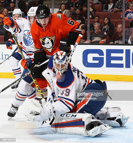 Rickard Rakell of the Anaheim Ducks looks for a rebound against Anders Nilsson and Ryan NugentHopkins of the Edmonton Oilers on November 11 2015 at...