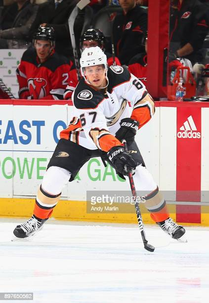 Rickard Rakell of the Anaheim Ducks plays the puck against the New Jersey Devils at Prudential Center on December 18 2017 in Newark New Jersey