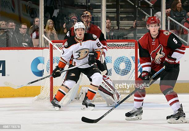 Rickard Rakell of the Anaheim Ducks positions himself between goaltender Mike Smith and Connor Murphy of the Arizona Coyotes during the second period...