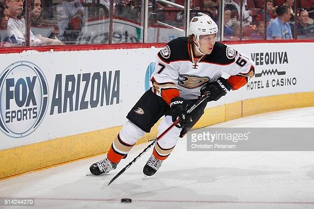 Rickard Rakell of the Anaheim Ducks skates with the puck during the NHL game against the Arizona Coyotes at Gila River Arena on March 3 2016 in...