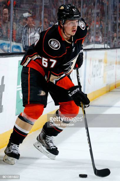 Rickard Rakell of the Anaheim Ducks skates with the puck during the game against the Calgary Flames on December 29 2017 at Honda Center in Anaheim...