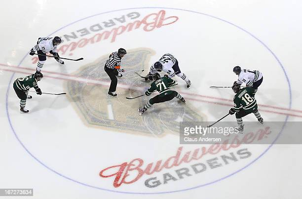 Rickard Rakell of the Plymouth Whalers takes the opening faceoff against Chris Tierney of the London Knights in game 1 of the Western Conference...