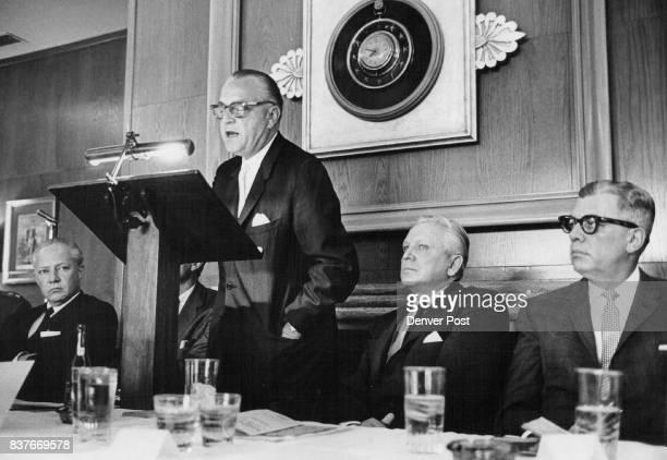 Rickenbaugh Ralph RALPH RICKENBAUGH ADDRESSING BETTER BUSINESS BUREAU MEETING RECITES ACCOMPLISHMENTS At left is Gov Steve McNichols and at right...