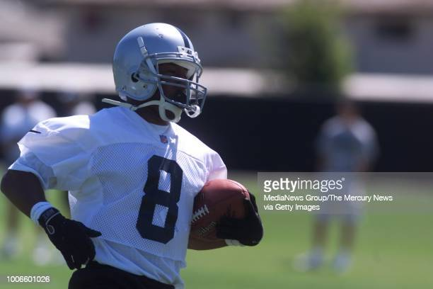 Rickey Dudley takes the ball upfield at the Raiders training camp in Napa