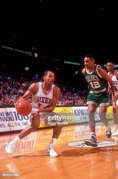 Rickey Green of the Philadelphia 76ers gets ready to shoot as he is defended by AJ Wynder of the Boston Celtics during an NBA game on April 18 1991...