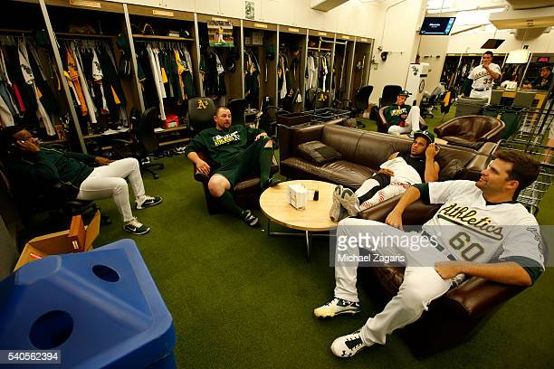 Rickey Henderson Billy Butler Henderson Alvarez and Andrew Triggs of the Oakland Athletics relax in the clubhouse prior to the game against the New...
