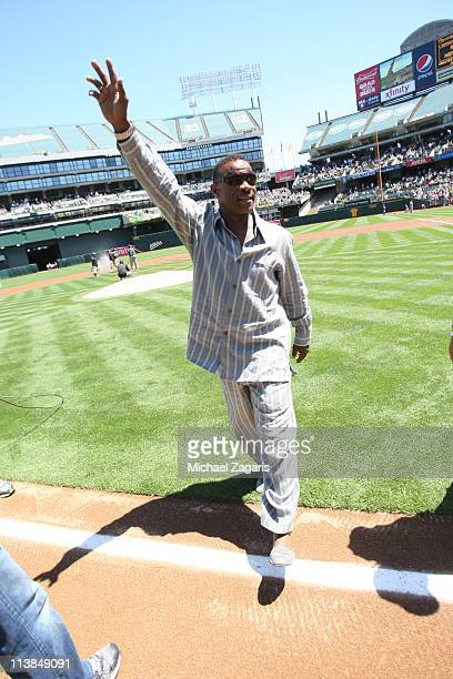 Rickey Henderson leaves the field after throwing out the first pitch before the game against the Texas Rangers at the OaklandAlameda County Coliseum...