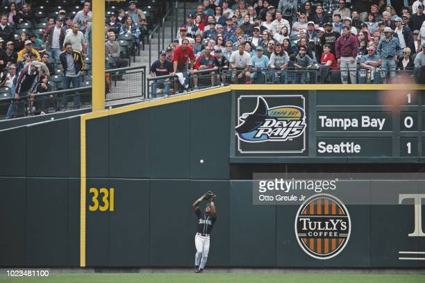 Rickey Henderson Leftfielder for the Seattle Mariners catches the ball as spectators look on during the Major League Baseball American League West...
