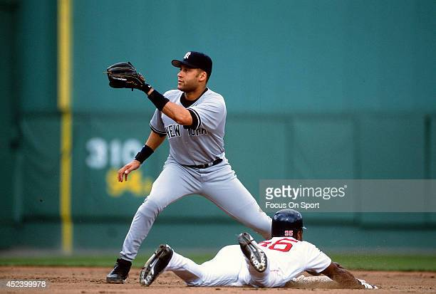 Rickey Henderson of the Boston Red Sox steals second base beating the throw down to Derek Jeter of the New York Yankees during an Major League...