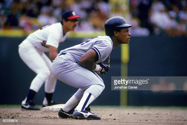 Rickey Henderson of the New York Yankees focuses on home plate as he prepares to run on a play during a game against the Chicago White Sox in 1987 at...