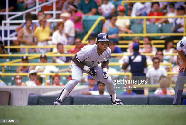 Rickey Henderson of the New York Yankees leadsoff of first base during a game against the Chicago White Sox in 1987 at Comiskey Park in Chicago...