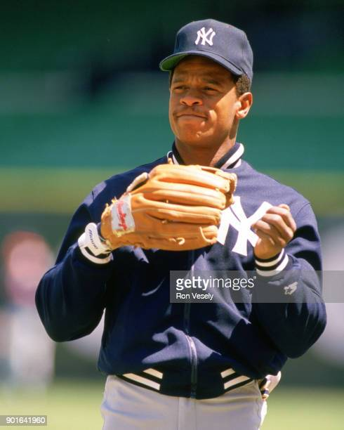 Rickey Henderson of the New York Yankees looks on during an MLB game versus the Chicago White Sox at Comiskey Park in Chicago Illinois during the...