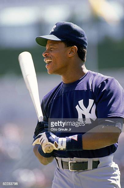 Rickey Henderson of the New York Yankees smiles during batting practice prior to a game against the Oakland Athletics in 1989 at Oakland-Alameda...