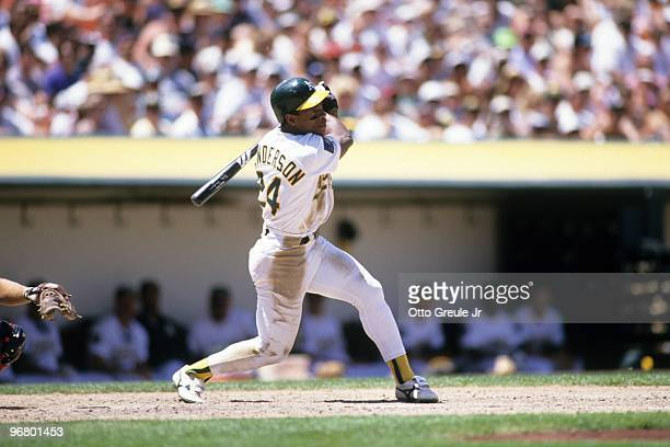 Rickey Henderson of the Oakland Athletics bats during their MLB game against the California Angels on June 26 1994 at OaklandAlameda County Coliseum...