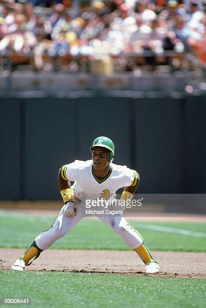 Rickey Henderson of the Oakland Athletics leads off the base during a game in the 1981 season at OaklandAlameda Coliseum in Oakland California