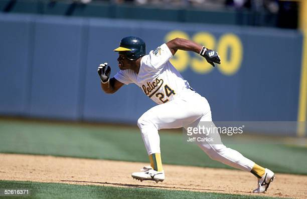 Rickey Henderson of the Oakland Athletics runs during a season game at Network Associates Coliseum in Oakland Califoornia Rickey Henderson played for...