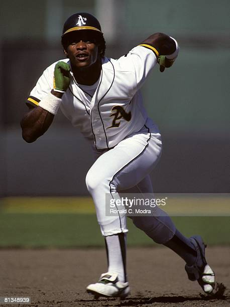 Rickey Henderson of the Oakland Athletics runs to second base in August 1982 in Oakland California