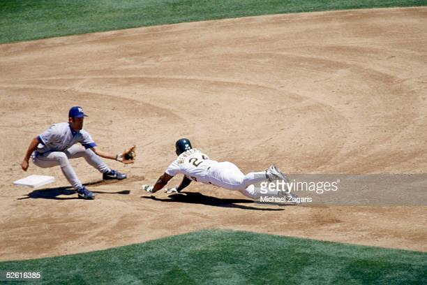 Rickey Henderson of the Oakland Athletics slides head first into second base during a season game at Network Associates Coliseum in Oakland,...