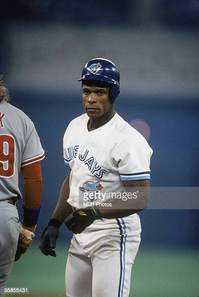 Rickey Henderson of the Toronto Blue Jays looks on during game six of the 1993 World Series against the Philadelphia Phillies at the Skydome on...